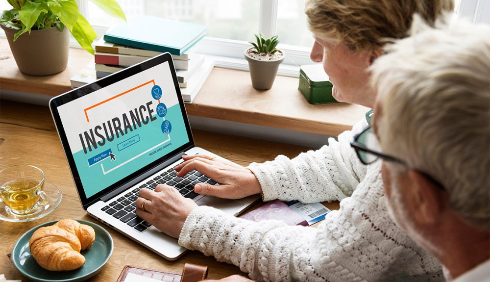 old Couple Searching for insurance in online