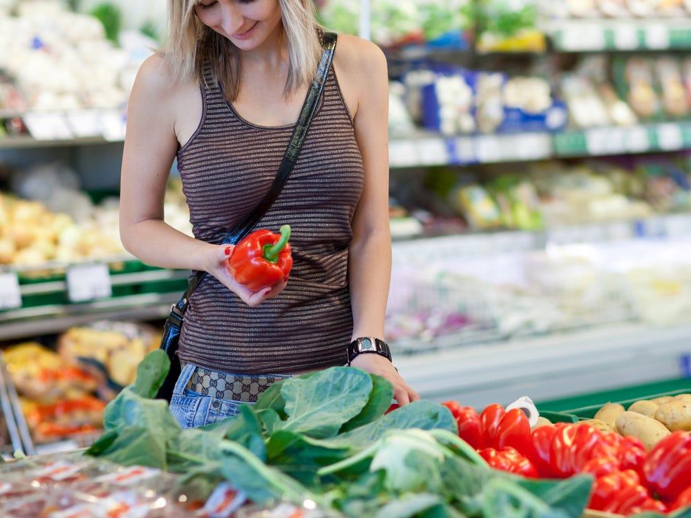women buying vegetables