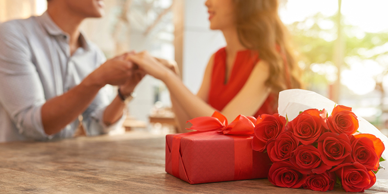 A men Propose to a girl with gift and flowers